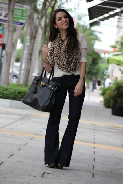 white blouse black pants cheetah scarf