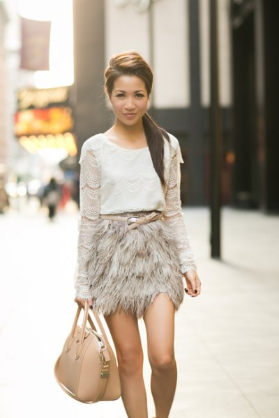 white crochet long sleeve top pink feather mini skirt