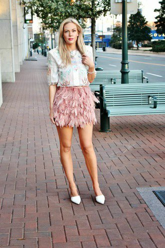 white floral embroidered blouse with pink mini feather skirt