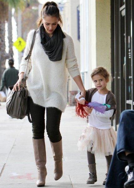 white fuzzy sweater dress black skinny jeans boots