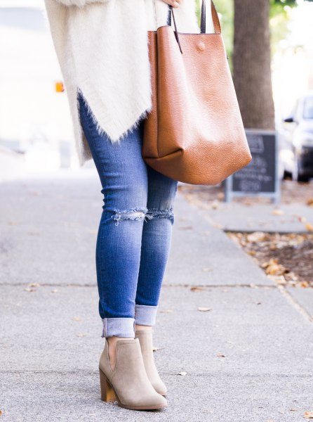 white fuzzy sweater light grey boots and jeans