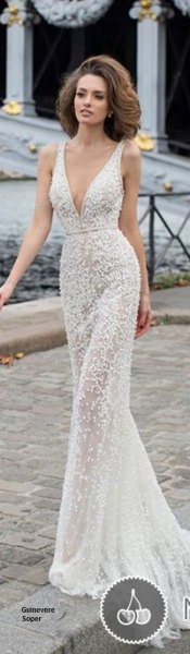 white gathered waist floor length flowy dress