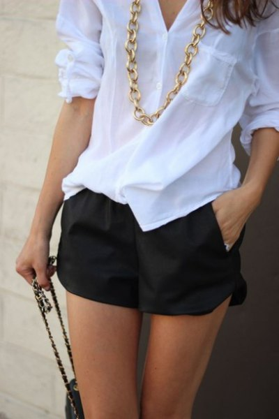 white linen shirt with black flowy shorts gold necklace