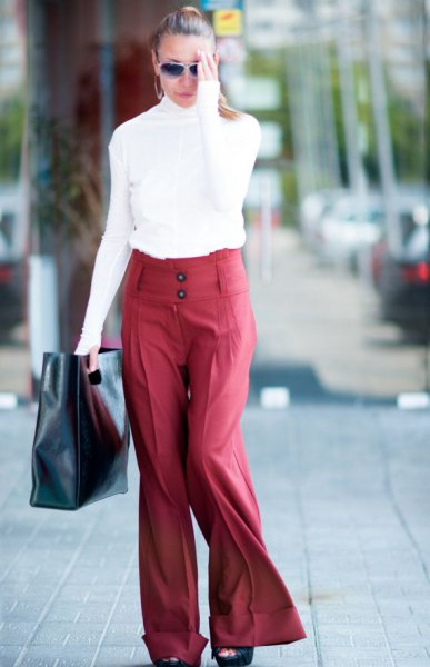 white mock neck long sleeve top with red wide leg pants