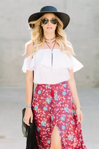 white off shoulder top with high slit skirt