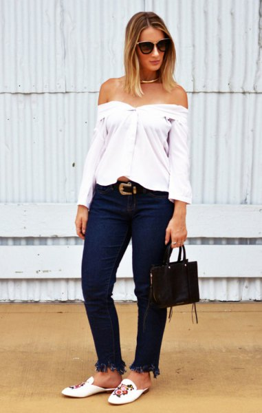 white off the shoulder blouse with embroidered slide loafers