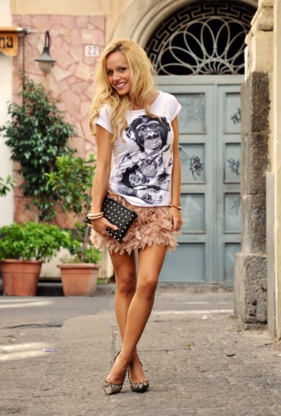 white print tee with pink feather skirt