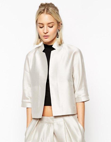 white silk three quarter sleeve jacket with black crop top