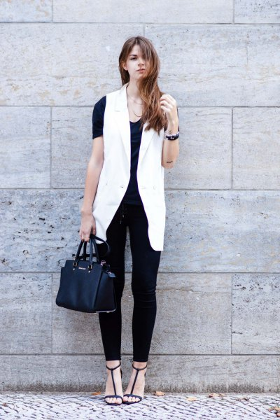 white sleeveless blazer with all black outfit