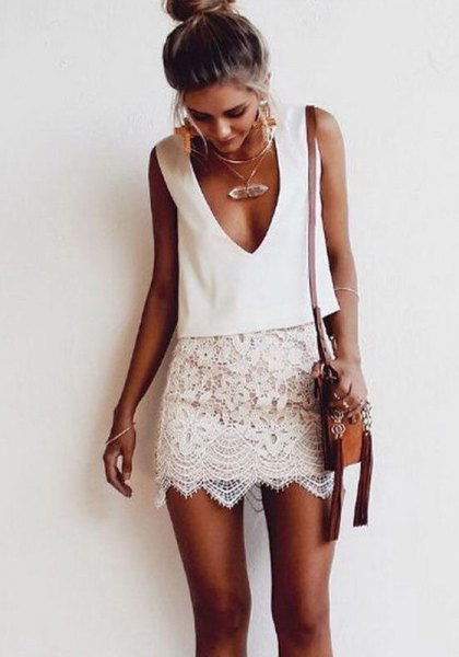 white sleeveless plunging neckline two piece lace dress
