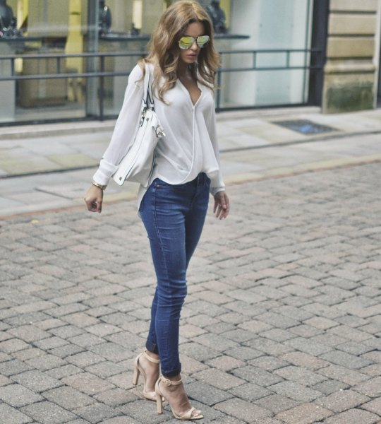 white wrap blouse with blue jeans and pink heels