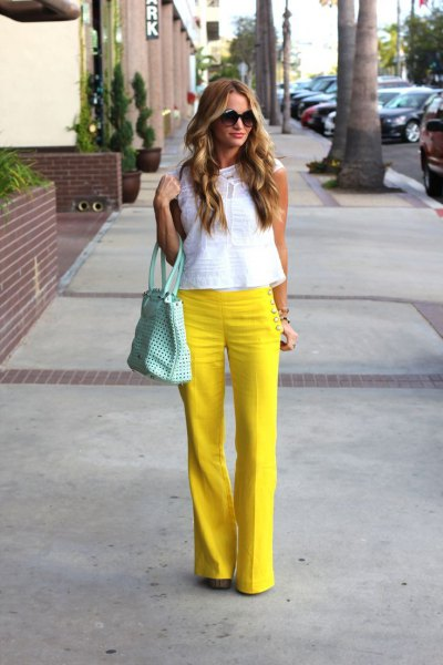 yellow flared sailor pants with white sleeveless lace top