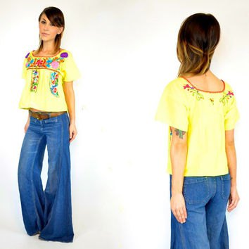 yellow mexican peasant blouse blue flared jeans