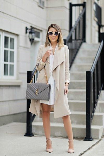 beige midi coat with white mini shirt dress