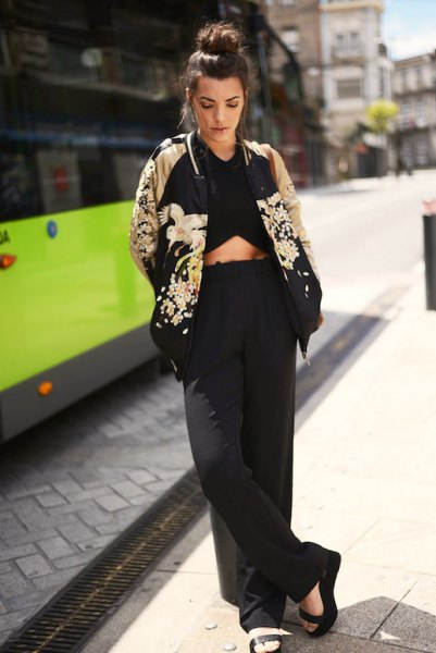 black and rose gold floral bomber jacket with crop top and wide leg pants