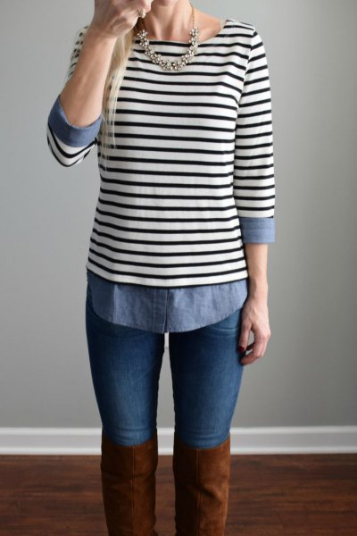 black and white striped boat neck top with chambray shirt and thigh high boots