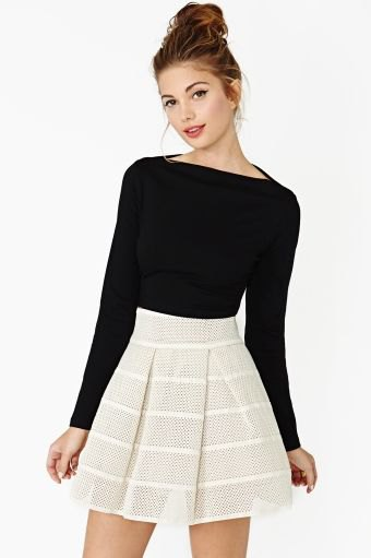 black boat neck long sleeve top with pale pink mini skater skirt
