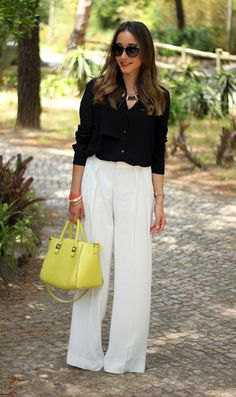 black button up shirt with white pants and lemon yellow leather purse