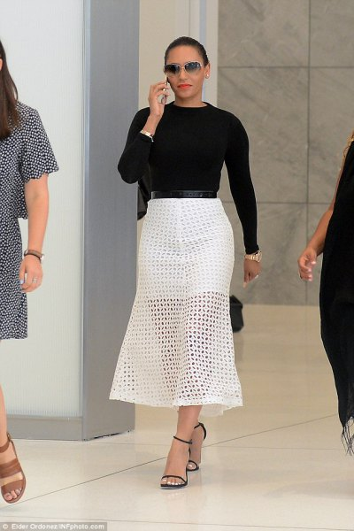 black fitted knit sweater with white maxi mesh skirt