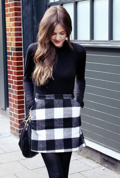 black fitted long sleeve t shirt with flannel mini checkered skirt