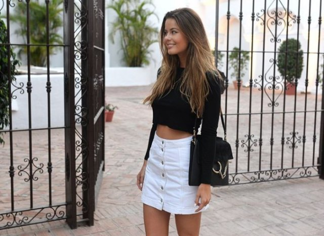 black form fitting cropped knit sweater with white mini button down skirt