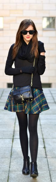 black form fitting sweater with green and navy plaid skater skirt