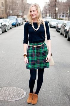 black half sleeve tee with green and navy plaid mini skirt