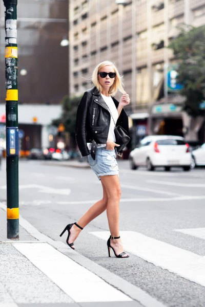 black leather jacket with light blue denim boyfriend shorts