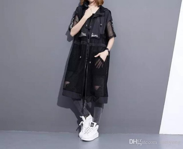black long mesh coat over white tee and grey jeans