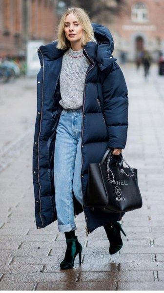 black long puffer coat with grey sweater and mom jeans