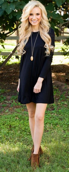 black long sleeve mini swing dress with camel ankle boots