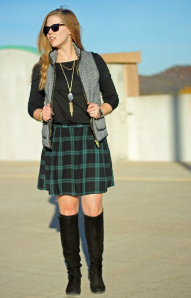 black long sleeve tee with green plaid skirt and grey vest