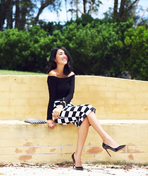 black off the shoulder top with checkered midi bodycon skirt