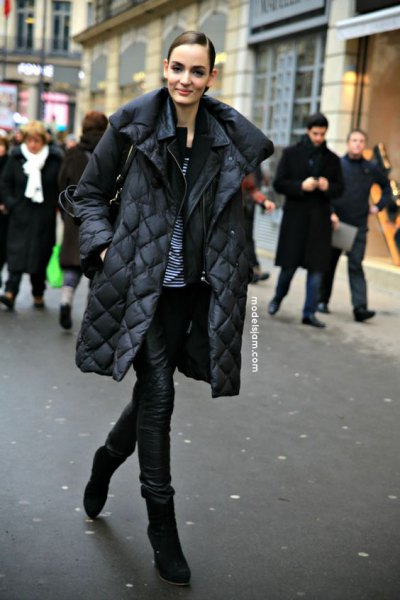 black quilted puffer coat with leather pants and boots