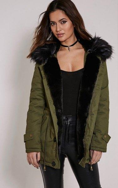 black scoop neck vest top with fur lined parka coat