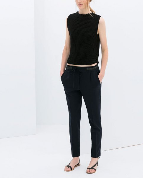 black sleeveless crop top with matching straight leg pants