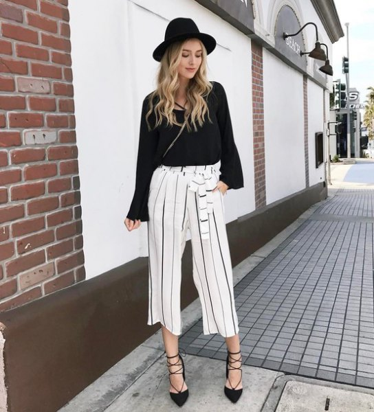 black sweater with white cropped wide leg pants