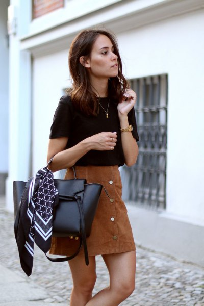 black t shirt with brown suede skirt