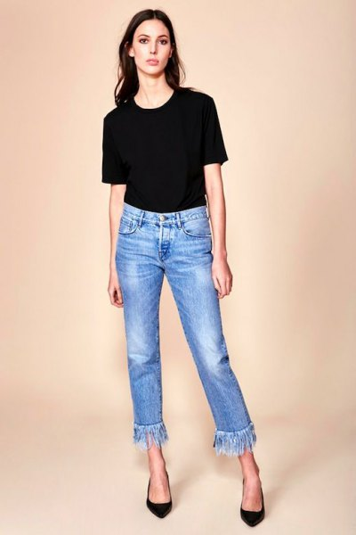 black t shirt with cropped blue fringe jeans