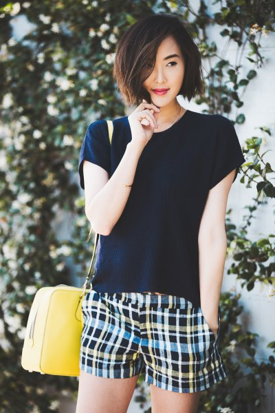 black t shirt with multi colored plaid shorts