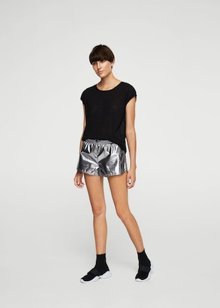 black t shirt with silver shorts and sneakers