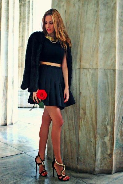 black teddy coat with navy pleated mini skirt