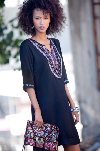 black tribal printed tunic dress and matching clutch bag