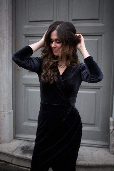 black velvet knee length dress with silver statement necklace