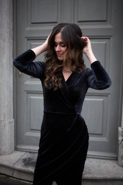 black velvet knee length dress with silver statement necklace