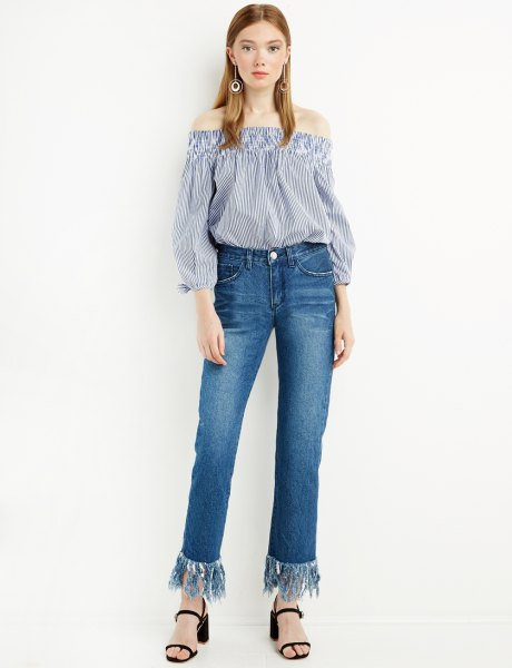 blue and white striped off the shoulder blouse with fringe hem jeans