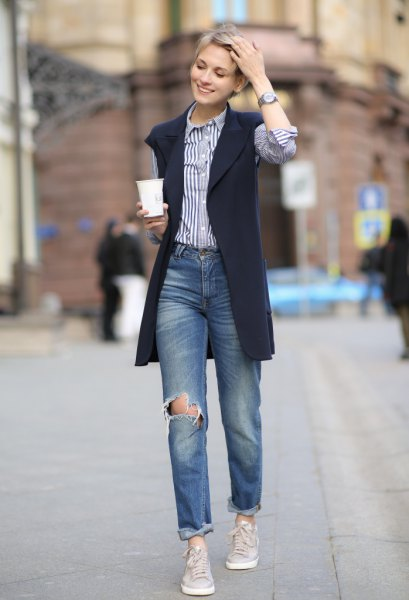 blue and white striped shirt with navy sleeveless blazer jacket