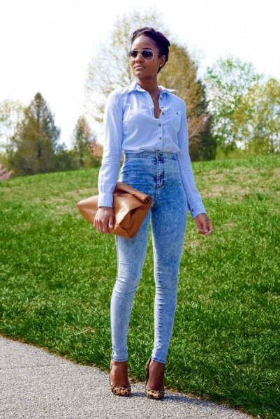 blue button up shirt with specially washed vintage jeans