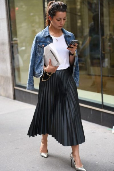 blue denim jacket with maxi black pleated skirt