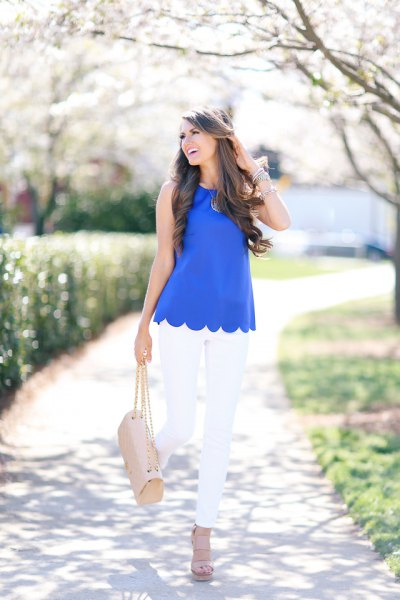 blue scalloped sleeveless shirt with white skinny jeans